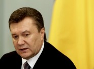 Ukraine's President Yanukovich looks on during a meeting with Russia's Prime Minister Putin in Moscow